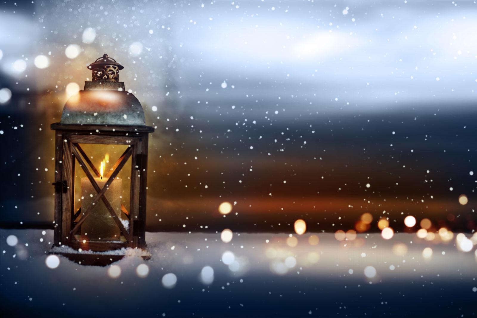 Burning Lantern In Snowy Winter